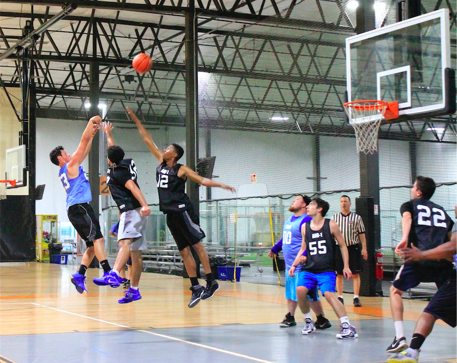 BS&B's John Brolet sinks a tough jumper over two defenders in their Week 4 win over And-1.
