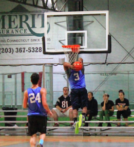 BS&B's Cam Tucker gets loose for a fast break two-handed dunk as Dileonardo looks on.